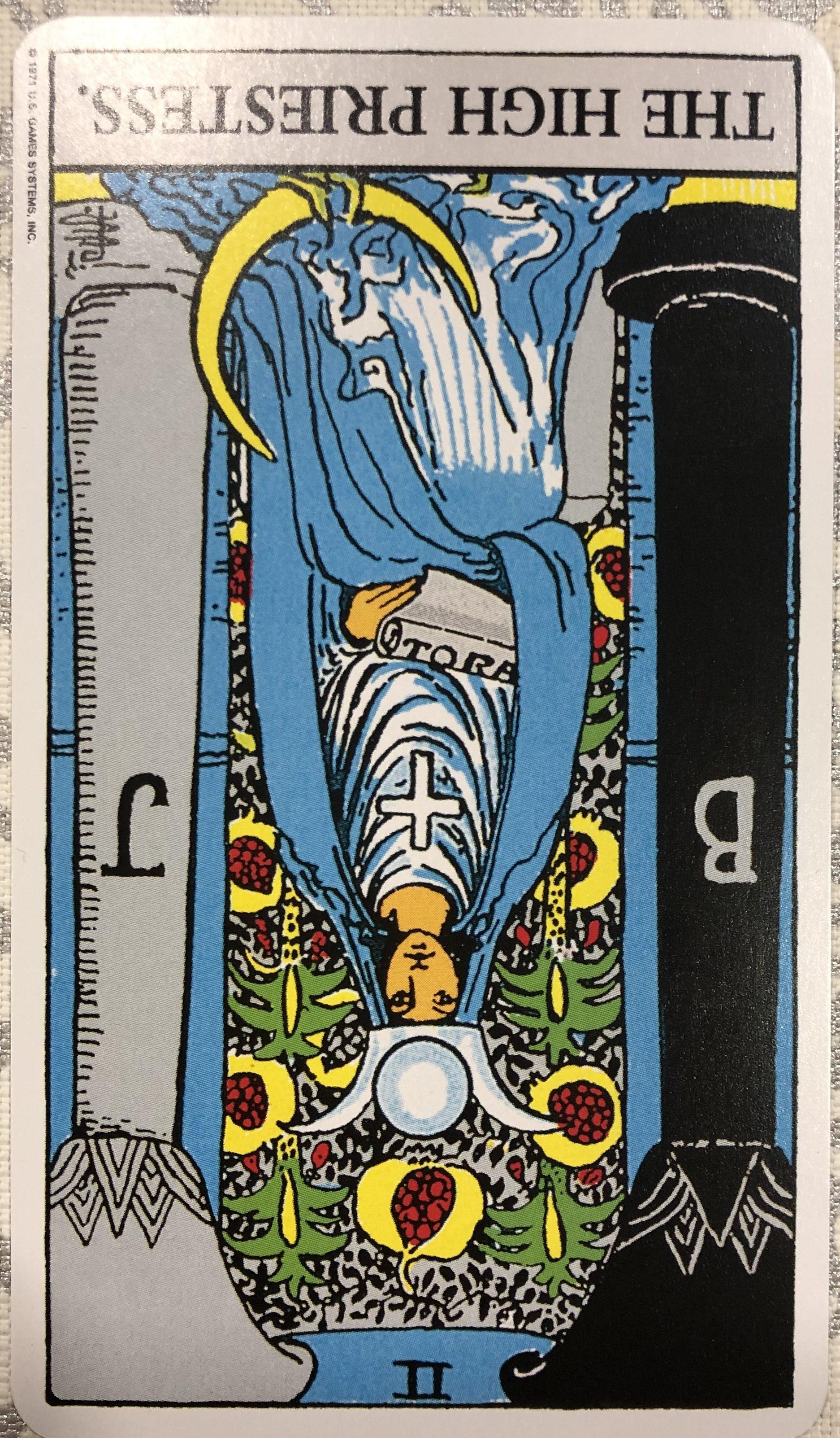 女司祭(逆位置)